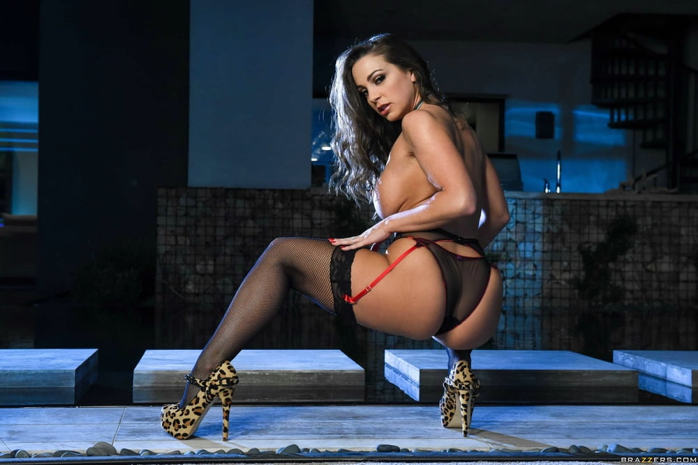 Abigail Mac in black stockings and high heels exposing her b